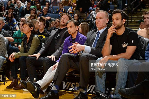 Mark Mastrov Vivek Ranadivé and Chris Mullin of the Sacramento Kings attend the game against the Golden State Warriors during the game on December 22...
