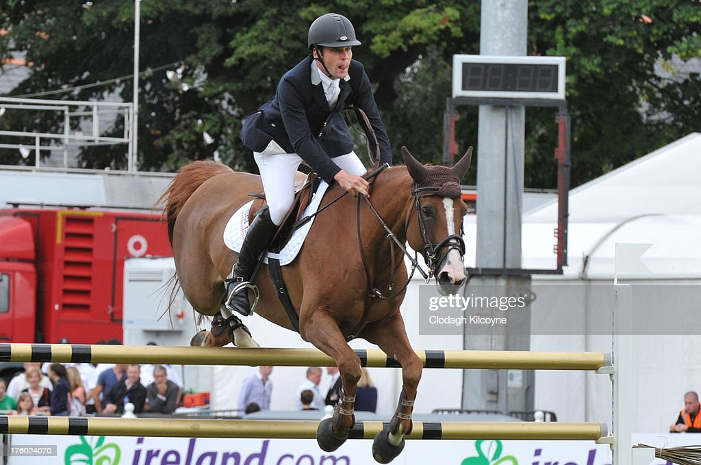 Mark McAuley and Par Trois of Ireland competes in the Longines International Showjumping Grand Prix of Ireland with a prize of EUR200,000 at the RDS Dublin Horse Show on August 11, 2013 in Dublin, Ireland.
