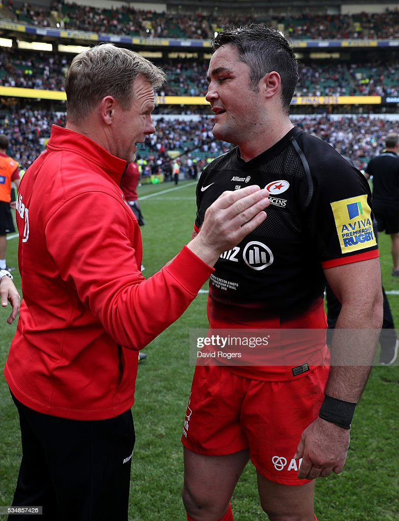 <a gi-track='captionPersonalityLinkClicked' href=/galleries/search?phrase=Mark+McCall&family=editorial&specificpeople=3570088 ng-click='$event.stopPropagation()'>Mark McCall</a>, Director of Rugby and <a gi-track='captionPersonalityLinkClicked' href=/galleries/search?phrase=Alex+Goode&family=editorial&specificpeople=2060375 ng-click='$event.stopPropagation()'>Alex Goode</a> of Saracens celebrate following their victory inthe Aviva Premiership final match between Saracens and Exeter Chiefs at Twickenham Stadium on May 28, 2016 in London, England.