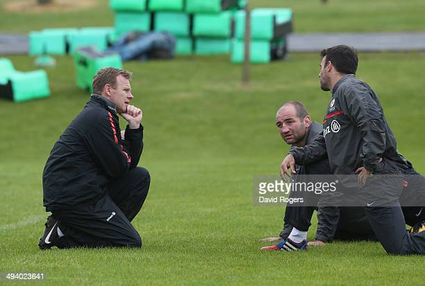 Mark McCall the Saracens director of rugby talks to Steve Borthwick and Neil de Kock during the Saracens training session on May 27 2014 in St Albans...