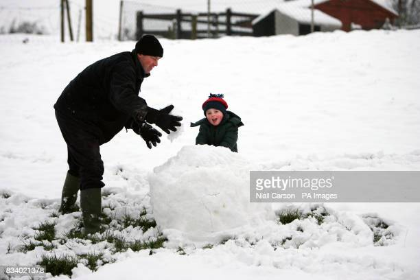 Mark McDonnell and his son Tom build a snowman in their garden in Dunleer Co Meath
