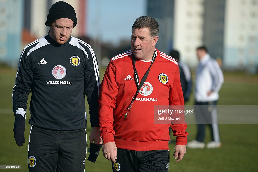 Mark McGhee assistant coach of Scotland chats with Charlie Adam as he take their first training session with Gordon Strachan as the new management team of Scotland at the Aberdeen Sports village on February 4, 2013 in Aberdeen,Scotland. Gordan Strachan will have his first game in charge against Estonia in an international friendly at Pittodrie on Wednesday.