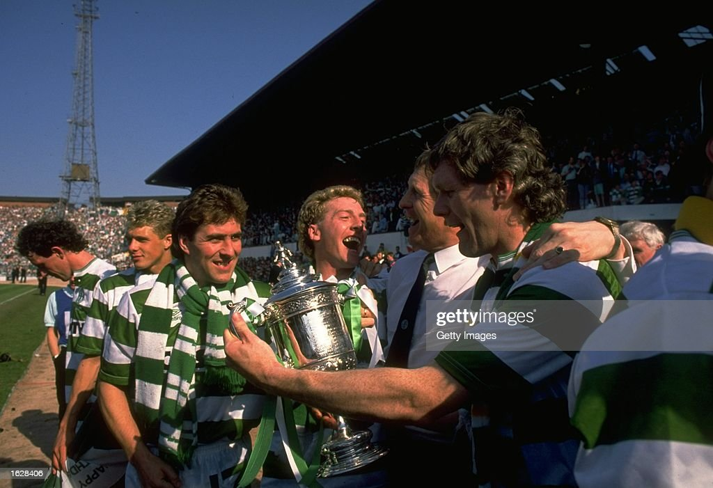 Mark McGhee Frank McAvennie McNeil and Roy Aitken all of Celtic celebrate with the trophy after winning the Scottish Cup Final against Dundee United...