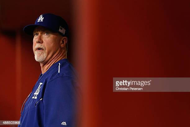 Mark McGwire of the Los Angeles Dodgers in the dugout during the MLB game against the Arizona Diamondbacks at Chase Field on September 11 2015 in...