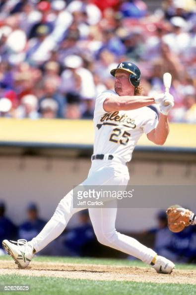 Mark McGwire of the Oakland Athletics bats during a 1996 season game at Network Associates Coliseum in Oakland California Mark McGwire played for the...