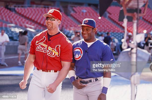Mark McGwire of the St Louis Cardinals and Sammy Sosa of the Chicago Cubs joke before the game at Busch Stadium on September 7 1998 in St Louis...