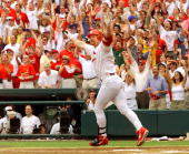 Mark McGwire of the St Louis Cardinals celebrates after hitting his 61st homerun against Chicago Cub's Mike Morgan at Busch Stadium 07 September in...