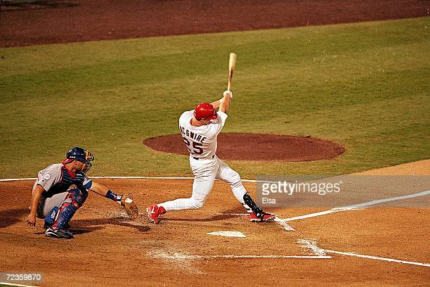 Mark McGwire of the St Louis Cardinals hit his 62nd home run of the season during the game against the Chicago Cubs at Busch Stadium in St Louis...