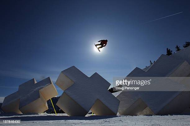 Mark McMorris of Canada soars over a feature as he practices for the men's snowboard slopestyle finals during Winter X Games 2012 at Buttermilk...