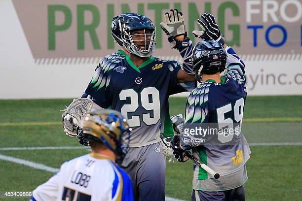 Mark McNeill and teammate Chris Lightner of the Chesapeake Bayhawks celebrate afer McNeill scored a first half goal against the Charlotte Hounds at...