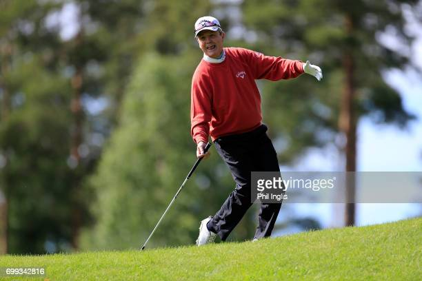 Mark McNulty of Ireland reacts to holing a chip shot on the 6th hole during the first round of the European Tour Properties Senior Classic played at...