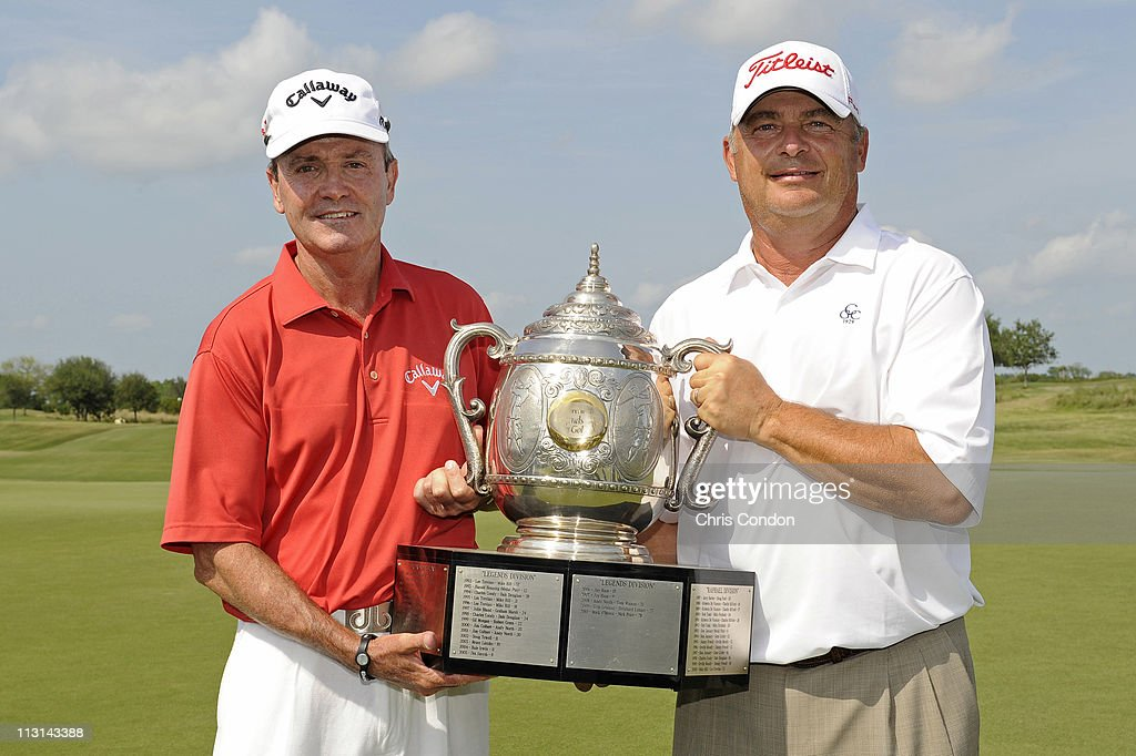 Mark McNulty of South Africa and David Eger pose with the tournament trophy after after the final round of the Legends Division at the Liberty Mutual...