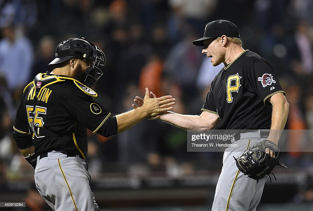<a gi-track='captionPersonalityLinkClicked' href=/galleries/search?phrase=Mark+Melancon&family=editorial&specificpeople=4900198 ng-click='$event.stopPropagation()'>Mark Melancon</a> #35 and Russell Martin #55 of the Pittsburgh Pirates celebrate defeating the San Francisco Giants 3-1 at AT&T Park on July 29, 2014 in San Francisco, California.