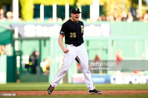 Mark Melancon of the Pittsburgh Pirates celebrates an out in the ninth inning against the St Louis Cardinals during Game Four of the National League...