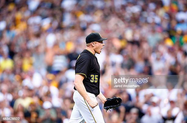 Mark Melancon of the Pittsburgh Pirates celebrates in the ninth inning following the 65 win against the Los Angles Dodgers during the game at PNC...
