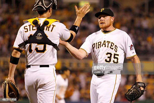 Mark Melancon of the Pittsburgh Pirates celebrates with Chris Stewart after defeating the St Louis Cardinals 52 at PNC Park on July 10 2015 in...