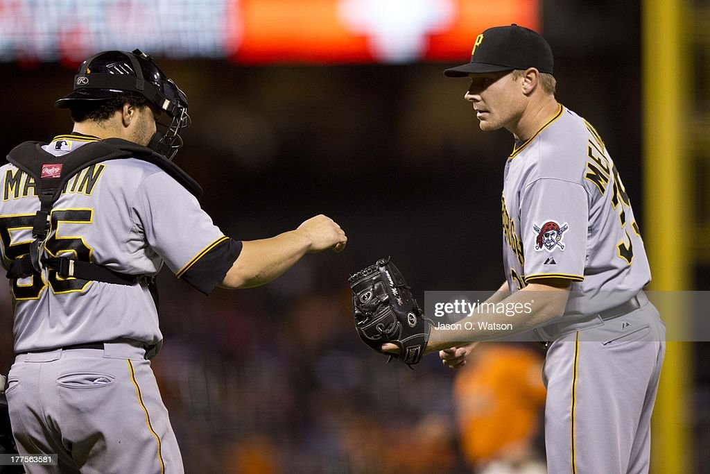 <a gi-track='captionPersonalityLinkClicked' href=/galleries/search?phrase=Mark+Melancon&family=editorial&specificpeople=4900198 ng-click='$event.stopPropagation()'>Mark Melancon</a> #35 of the Pittsburgh Pirates is congratulated by <a gi-track='captionPersonalityLinkClicked' href=/galleries/search?phrase=Russell+Martin+-+Baseball+Player&family=editorial&specificpeople=13764024 ng-click='$event.stopPropagation()'>Russell Martin</a> #55 after the game against the San Francisco Giants at AT&T Park on August 23, 2013 in San Francisco, California. The Pittsburgh Pirates defeated the San Francisco Giants 3-1.