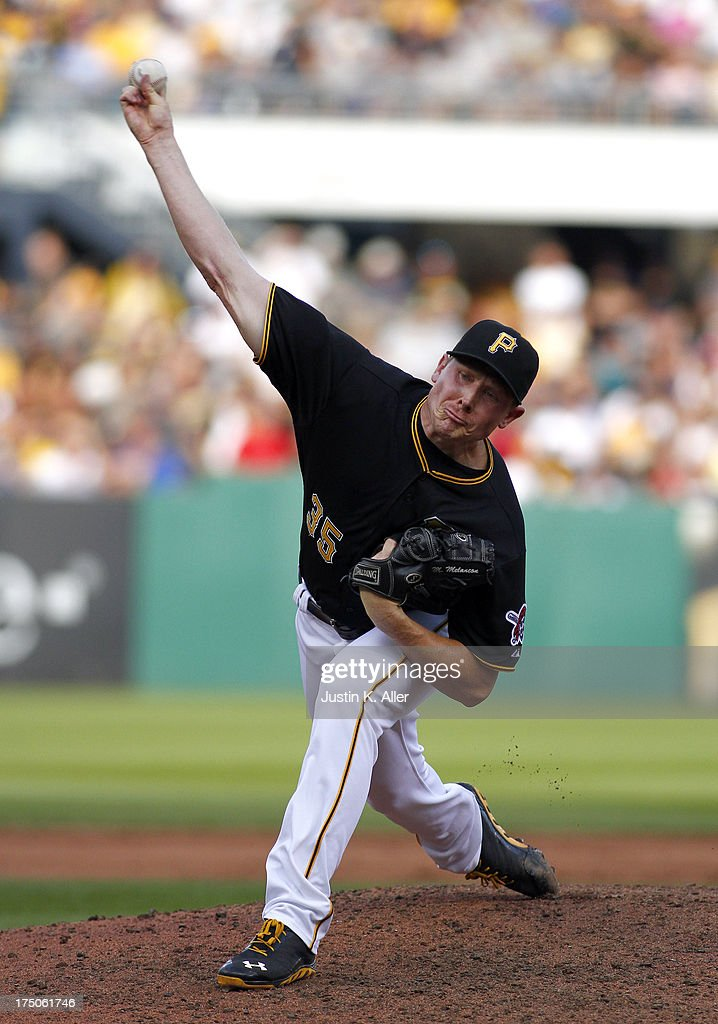 <a gi-track='captionPersonalityLinkClicked' href=/galleries/search?phrase=Mark+Melancon&family=editorial&specificpeople=4900198 ng-click='$event.stopPropagation()'>Mark Melancon</a> #35 of the Pittsburgh Pirates pitches against the St. Louis Cardinals during the game on July 30, 2013 at PNC Park in Pittsburgh, Pennsylvania. The Pirates defeated the Cardinals 2-1 in eleven innings.