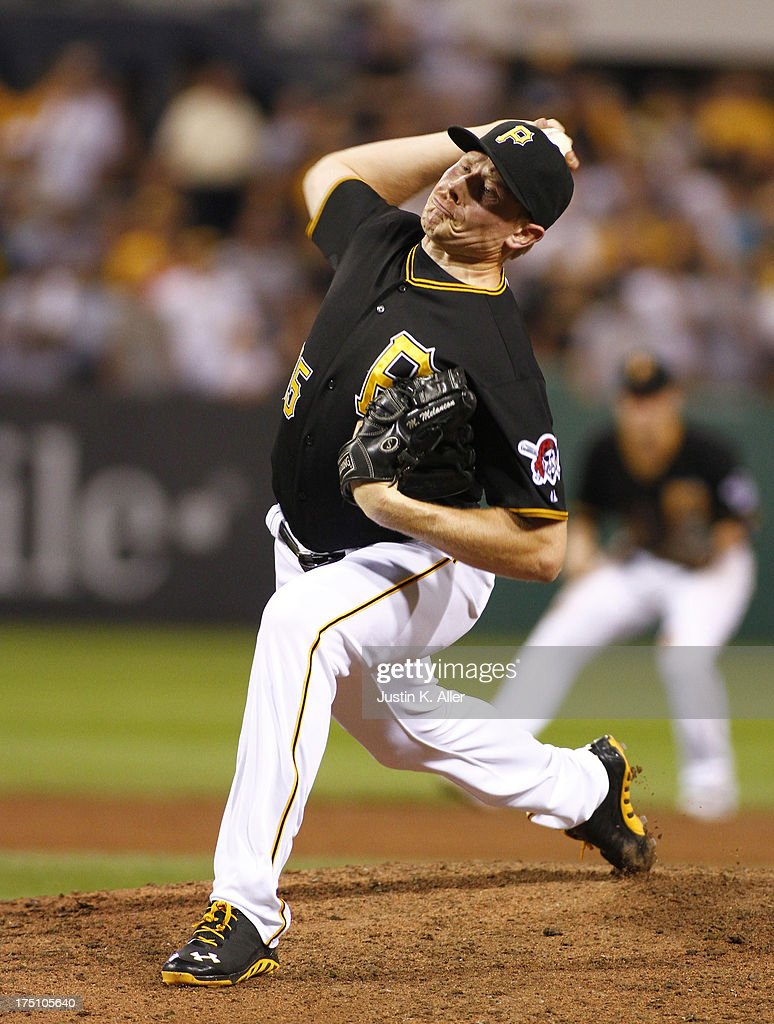 <a gi-track='captionPersonalityLinkClicked' href=/galleries/search?phrase=Mark+Melancon&family=editorial&specificpeople=4900198 ng-click='$event.stopPropagation()'>Mark Melancon</a> #35 of the Pittsburgh Pirates pitches in the ninth inning against the St. Louis Cardinals during the game on July 31, 2013 at PNC Park in Pittsburgh, Pennsylvania. The Pirates defeated the Cardinals 5-4.