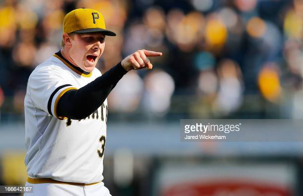 Mark Melancon of the Pittsburgh Pirates reacts following his save in the 9th inning against the Cincinnati Reds on April 14 2013 at PNC Park in...