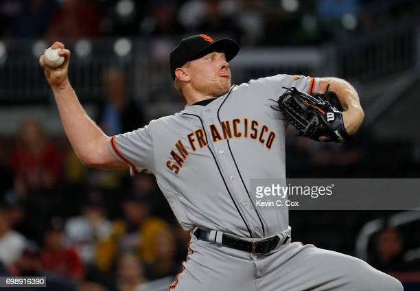 Mark Melancon of the San Francisco Giants pitches in the ninth inning against the Atlanta Braves at SunTrust Park on June 20 2017 in Atlanta Georgia
