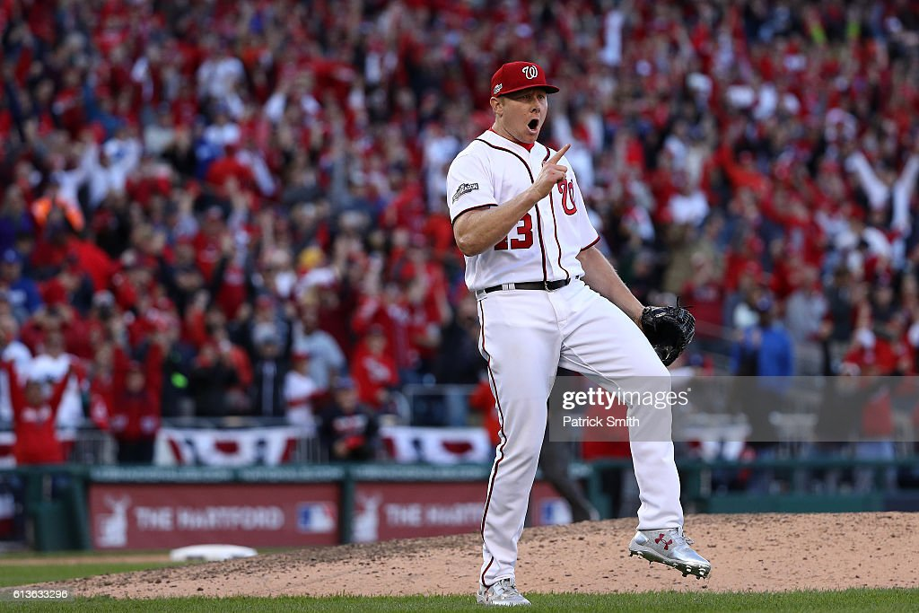 Mark Melancon #43 of the Washington Nationals celebrates after the Washington Nationals defeated the Los Angeles Dodgers 5-2 in game two of the National League Division Series at Nationals Park on October 9, 2016 in Washington, DC.