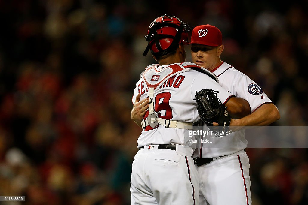 Mark Melancon #43 of the Washington Nationals celebrates with teammate Pedro Severino #29 of the Washington Nationals after the Washington Nationals defeated the Miami Marlins 2-1 at Nationals Park on October 1, 2016 in Washington, DC.