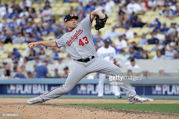 Mark Melancon of the Washington Nationals pitches in the ninth inning while taking on the Los Angeles Dodgers in game three of the National League...