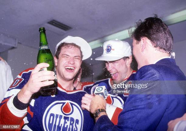 Mark Messier and Esa Tikkanen of the Edmonton Oilers celebrate in the locker room after Game 5 of the 1990 Stanley Cup Finals against the Boston...