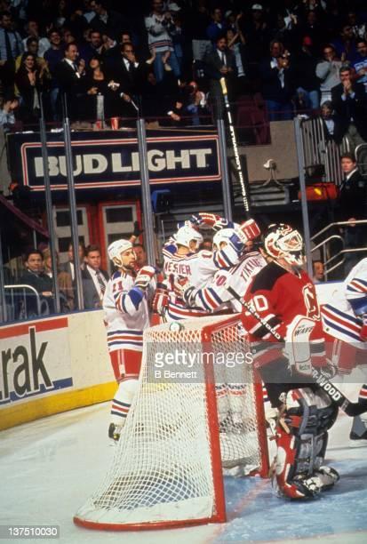 Mark Messier Esa Tikkanen and Sergei Zubov of the New York Rangers celebrate their goal against goalie Martin Brodeur of the New Jersey Devils during...