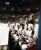 Mark Messier Glen Anderson Don Murdoch Head Coach Glen Sather and Wayne Gretzky of the Edmonton Oilers look on from the bench area during an NHL game...
