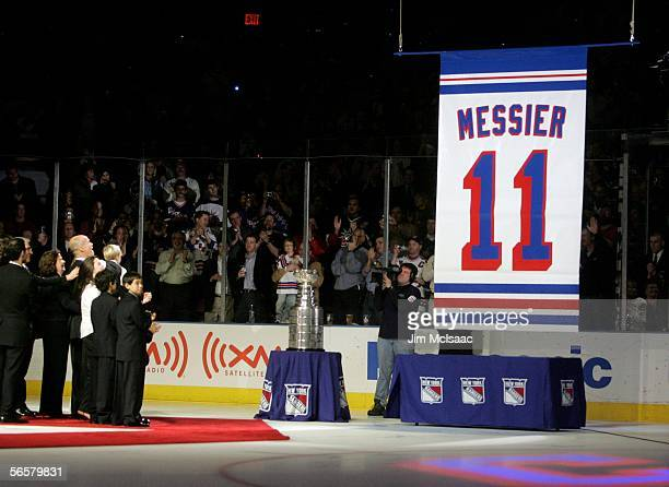Mark Messier is surrounded by his family as his banner is raised to the rafters during the ceremony to retired his on January 12 2006 at Madison...