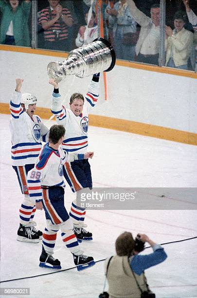 Mark Messier Marty McSorley and Wayne Gretzky of the Edmonton Oilers celebrate their Stanley Cup victory over the Philadelphia Flyers after Game 7 of...