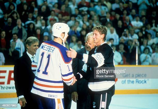 Mark Messier of the Edmonton Oilers congratulates Wayne Gretzky of the Los Angeles Kings after he scored his 1851st career NHL point on October 15...