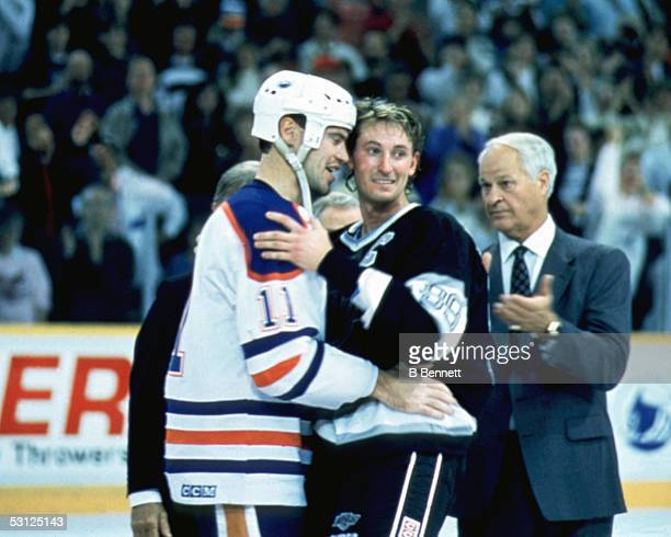 Mark Messier of the Edmonton Oilers congratulates Wayne Gretzky of the Los Angeles Kings after Gretzky scored the 1851st point of his career as...