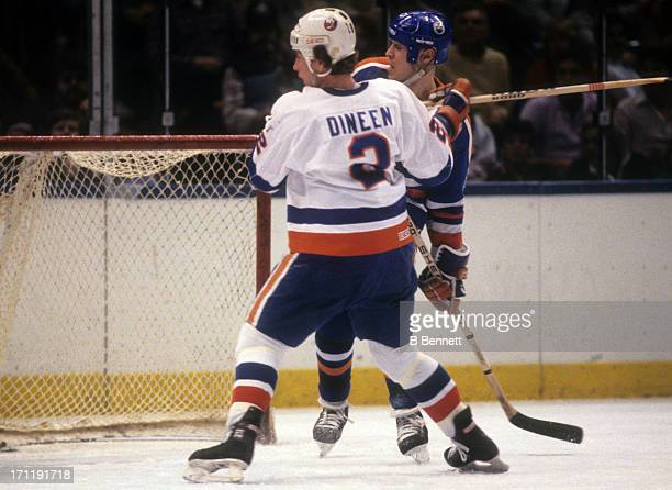 Mark Messier of the Edmonton Oilers is checked by Gord Dineen of the New York Islanders during the 1984 Stanley Cup Finals in May 1984 at the Nassau...