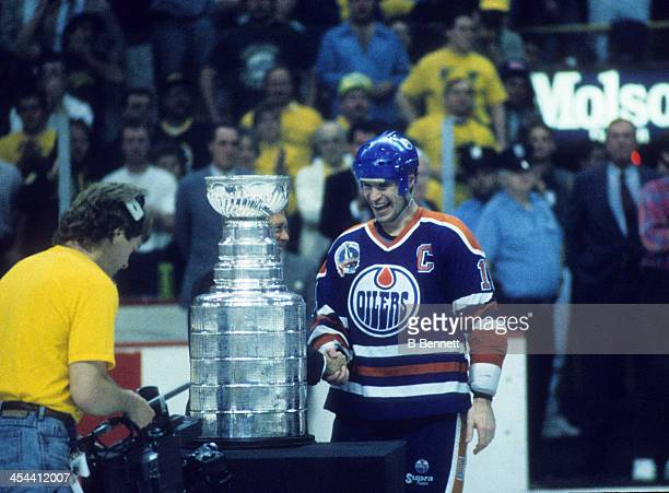 Mark Messier of the Edmonton Oilers is presented the Stanley Cup Trophy after Game 5 of the 1990 Stanley Cup Finals against the Boston Bruins on May...