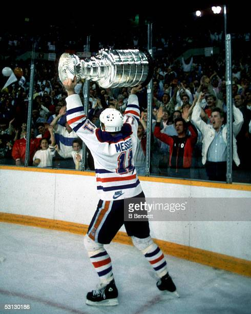 Mark Messier of the Edmonton Oilers skates around the rink celebrating with the crowd after the Oilers Game 7 win over the Philadelphia Flyers on May...