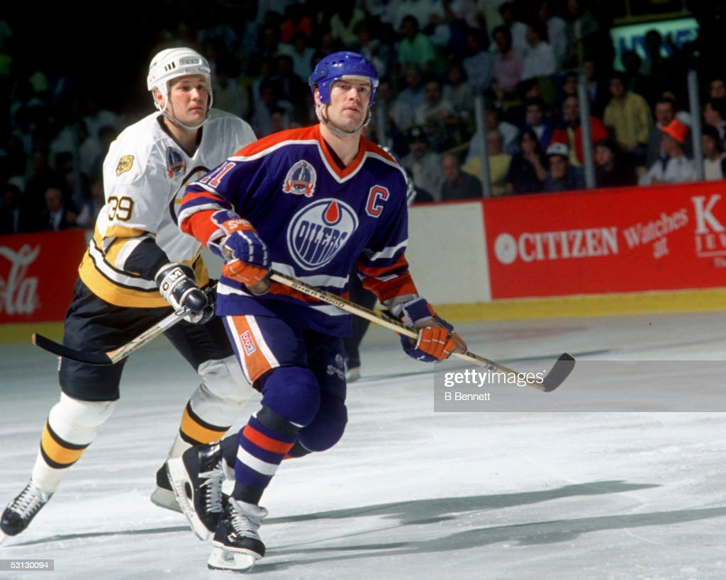 Mark Messier #11 of the Edmonton Oilers skates on the ice against the Boston Bruins during the 1990 Stanley Cup Finals in May, 1990 at the Boston Garden in Boston, Massachusetts.