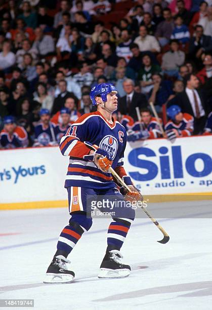 Mark Messier of the Edmonton Oilers skates on the ice during an NHL game against the Philadelphia Flyers on December 2 1990 at the Spectrum in...