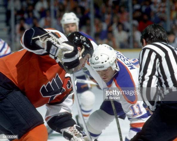 Mark Messier of the Edmonton Oilers takes the faceoff during the 1987 Stanley Cup Finals against the Philadelphia Flyers in May 1987 at the...