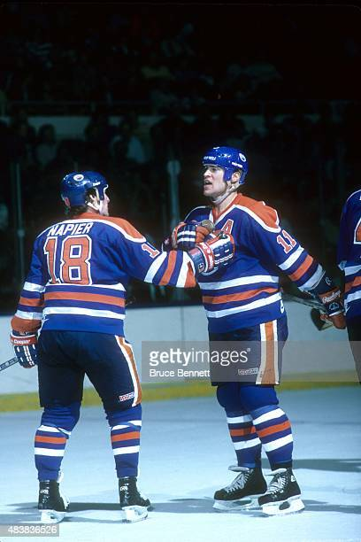Mark Messier of the Edmonton Oilers yells on the ice as his teammate Mark Napier holds him back during an NHL game against the New York Islanders on...