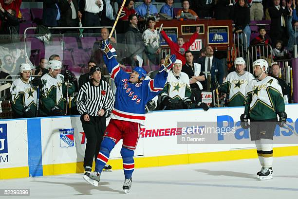 Mark Messier of the New York Rangers celebrates after scoring an empty net goal as he passes Gordie Howe to become 2nd all time in NHL points against...