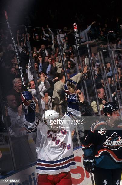 Mark Messier of the New York Rangers celebrates after scoring during an NHL game against the New York Islanders on January 2 1997 at the Madison...