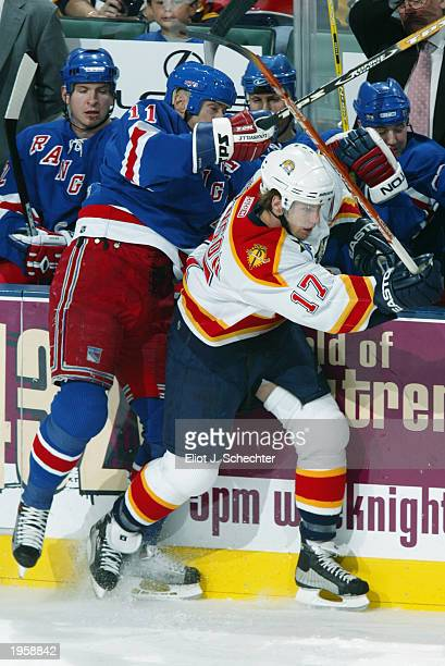 Mark Messier of the New York Rangers tangles with Ryan Johnson of the Florida Panthers in front of the Rangers bench during the NHL game at the...