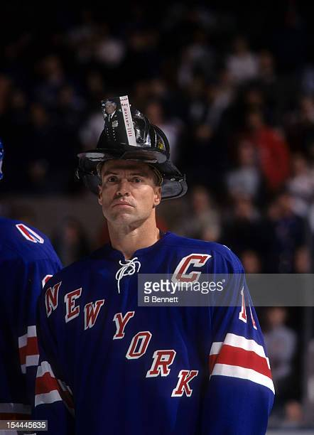 Mark Messier of the New York Rangers wears an NYFD helmet to support the victims of the September 11 attacks on New York City on October 7 2001 at...