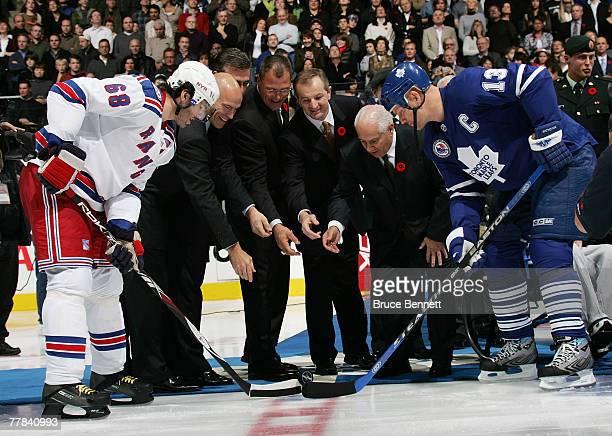 Mark Messier Ron Francis Scott Stevens Al MacInnis and Jim Gregory drop the game opening puck between Jaromir Jagr the New York Rangers and Mats...