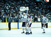 Mark Messier Wayne Gretzky and Esa Tikkanen of the Edmonton Oilers celebrate with Stanley Cup Trophy after Game 4 of the 1988 Stanley Cup Finals...