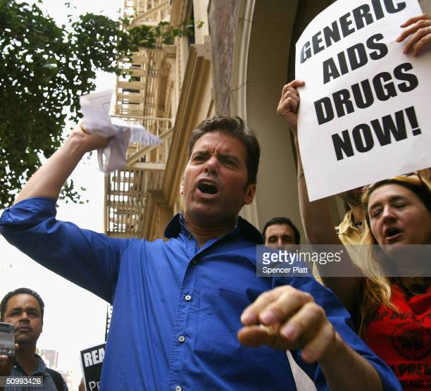 Mark Milano and other members of ACT UP/New York the AIDS Coalition to Unleash Power tear up a fake check from George W Bush during a protest June 24...