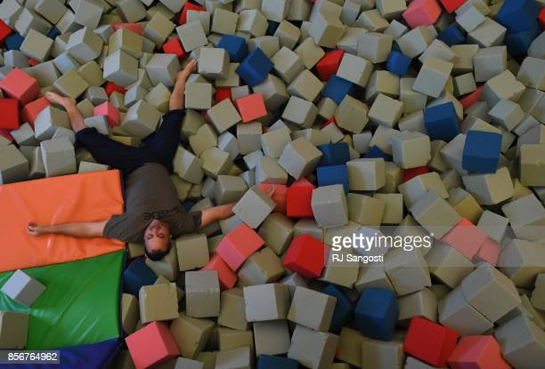 Mark Miller an Army veteran lies in a foam pit at the Grand Park Community Recreation Center on October 2 2017 in Fraser Colorado Davis and his...